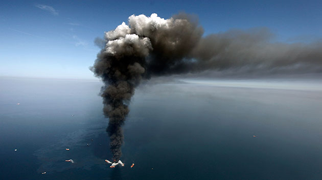 A large plume of smoke rises from fires on BP's Deepwater Horizon offshore oil rig, in April 2010. Gerald Herbert/AP