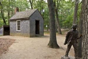 Replica_of_Thoreau's_cabin_near_Walden_Pond_and_his_statue